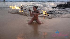 She puts on a show for all at the nude beach
